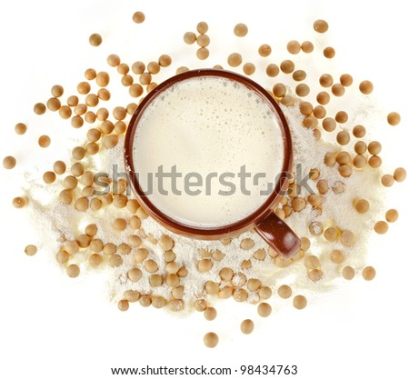 powdered milk drink in a clay cup with soy beans on white background - stock photo