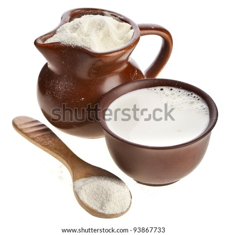 powdered milk drink  in clay  pitcher and cup on white background - stock photo