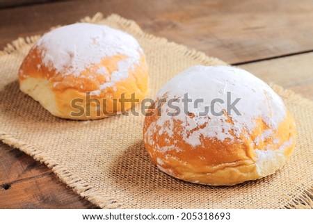 Powdered sugar sweet buns - stock photo