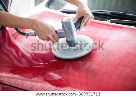 Power buffer machine for cleaning the body of a car from scratch - stock photo