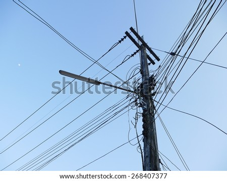 Power cable and electric hydro lines outdoors - stock photo
