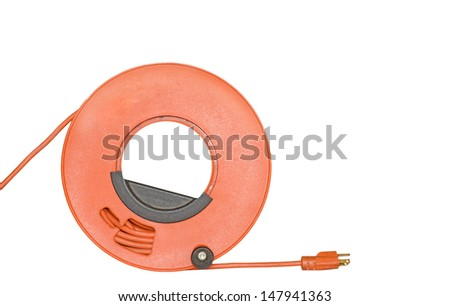 Power cord extension,3 prong plug wound on orange plastic spool,black handle.Rolled up sheathed electric cable for home or office to supply power. Isolated on white background.Room for text,copyspace. - stock photo