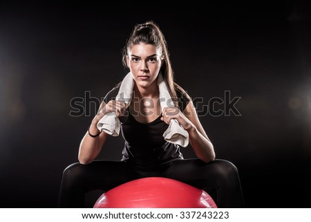 Power Fitness Girl On Red Fitness Ball - stock photo