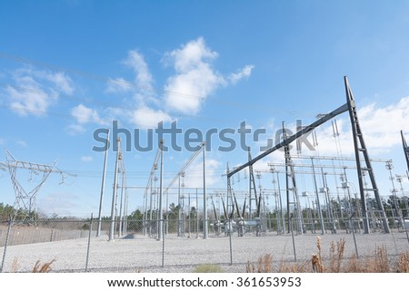 Power from an electrical power plant is tranported to a substation. The substation consists of many inductors where the voltage received from the power plant is stepped up to high voltage. - stock photo