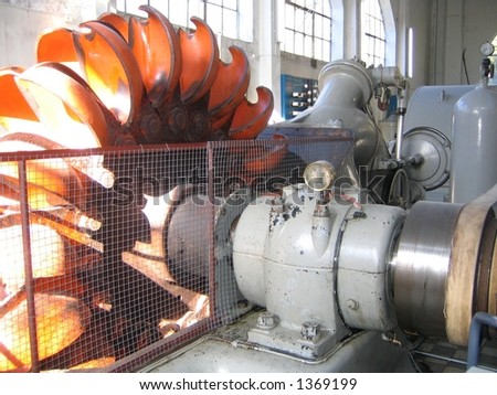 Power generator turbine in a water power station. Made in 1900 - stock photo