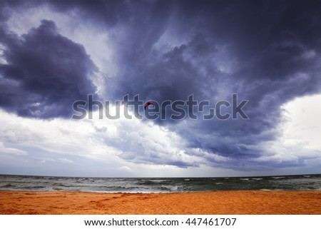 Power kite in sea and storm sky. Wide angle view. - stock photo