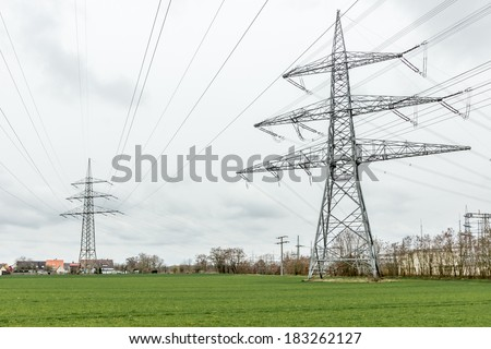 Power line above the village - stock photo