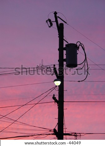 Power line backed by sunset - stock photo
