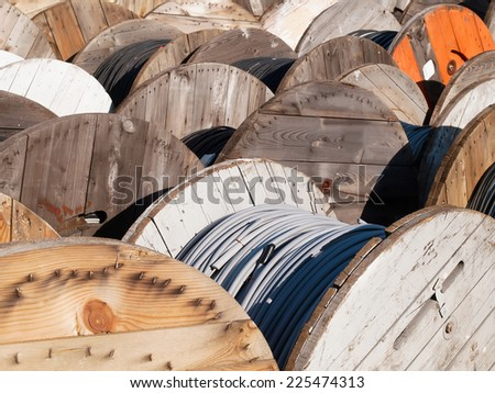 power line cables on wooden spools - stock photo