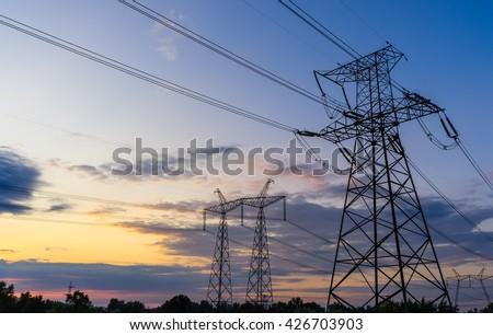Power Line. pylon against a blue sky. - stock photo
