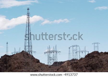 Power lines at Hoover Dam located on the Colorado River between Nevada and Arizona. - stock photo