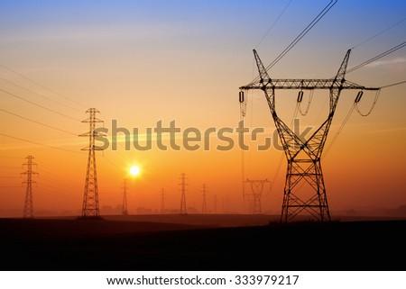 Power lines at sunrice - stock photo