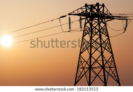 power lines during smoggy sunset - stock photo