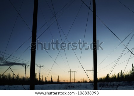 Power lines in the winter, Sweden. - stock photo