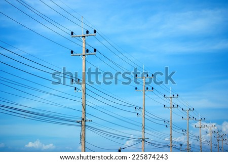 Power lines on the blue sky - stock photo