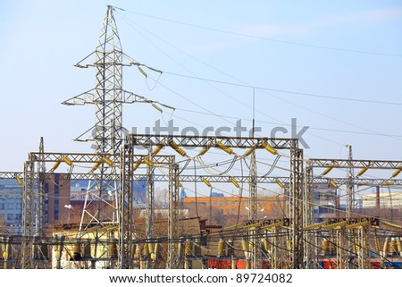 Power lines with pylons near a transformer station - stock photo