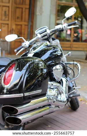 power motorcycle chrome exhaust and engine closeup - stock photo