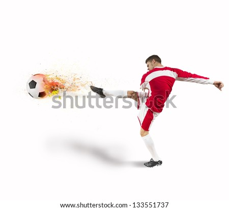 Power of a football player with fire in the ball - stock photo