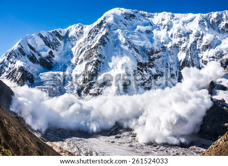Power of nature. Real huge avalanche comes from a big mountain (Shkhara, 5,193 m), Caucasus, Kabardino-Balkaria, Bezengi region, Russia - stock photo