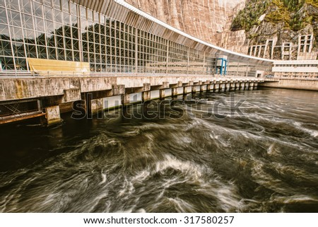 Power of Water in River on Hydro electric plant Dam - stock photo