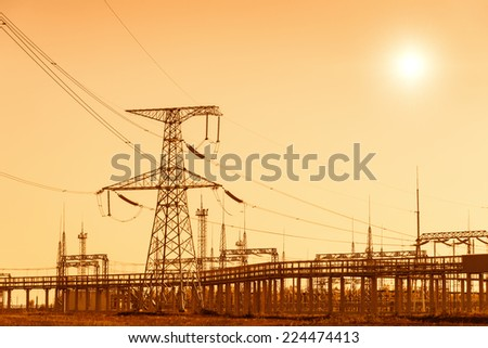 Power plant and pylons, warm toned - stock photo