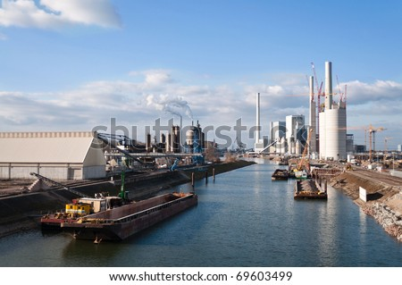Power plant construction site on the water - stock photo