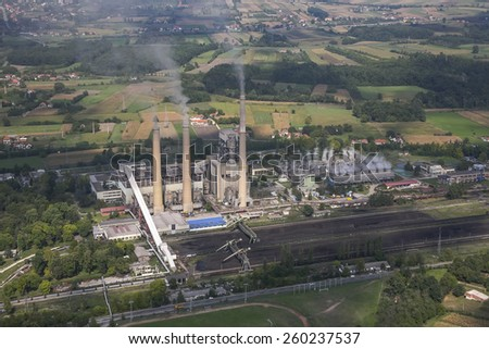 Power plant in coal mine, aerial view - stock photo