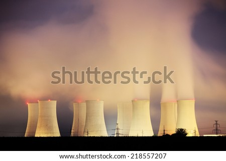 Power plant Nuclear by night - stock photo