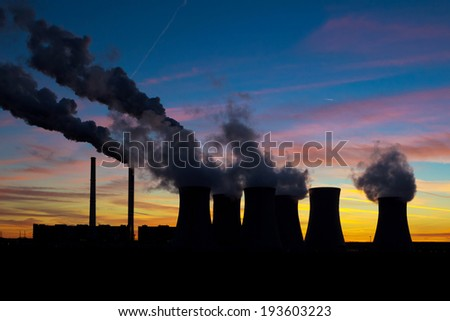 Power plant silhouette on evening sky - stock photo