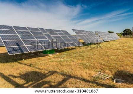 Power plant using renewable solar energy with sun. - stock photo