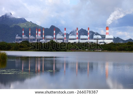 Power Plant with reflection on the water - stock photo