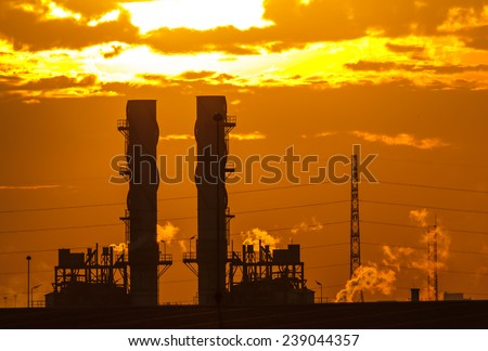 Power plants in the early morning - stock photo