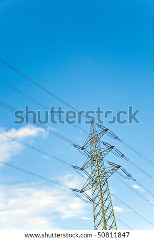 power pole  with blue sky background and white clouds - stock photo