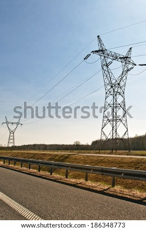 power poles along the highway - stock photo