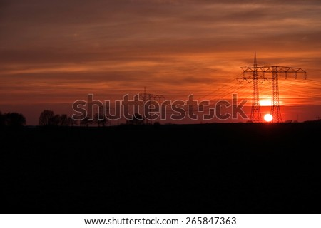 Power Poles in the Sunset, Germany - stock photo