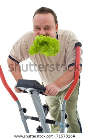 Power slimming concept with overweight man on exercise machine eating fresh green salad - isolated - stock photo