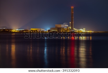 Power Station at Night. Belfast Lough, County Antrim, Northern Ireland. - stock photo