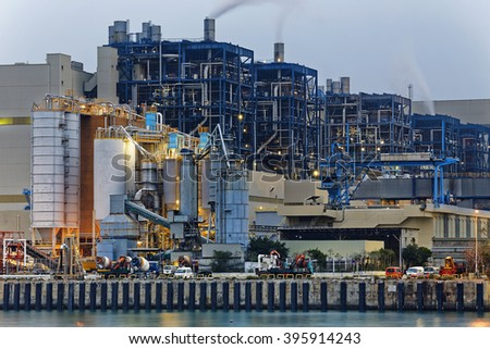 Power station industry building , petrochemical plant with lots of pipes - stock photo
