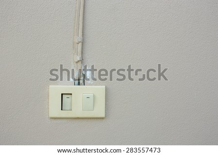 Power switch on concrete wall - stock photo
