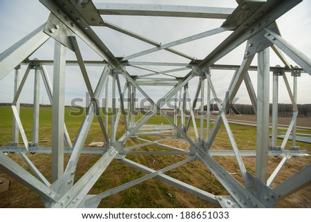 power tower lying on the ground before installation - stock photo