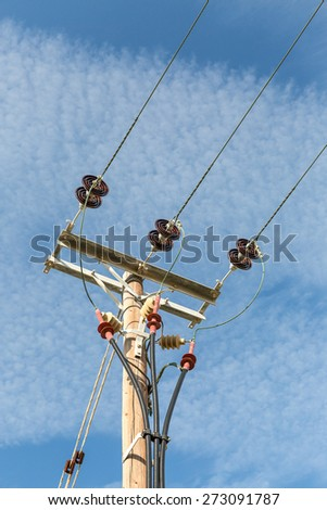 Power Wired Lines against the blue sky - stock photo