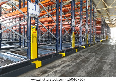 Powered mobile shelving system in distribution warehouse - stock photo