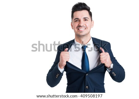 Powerful and confident young salesman opening his suit jacket as superhero metaphor - stock photo