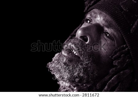 Powerful Black and White Image of Homeless Black Man - stock photo
