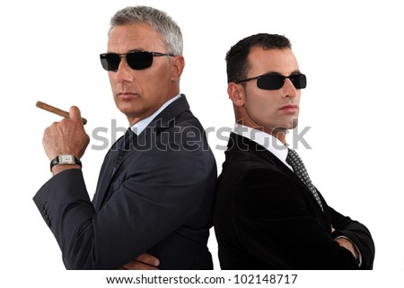 Powerful businessmen in sunglasses - stock photo