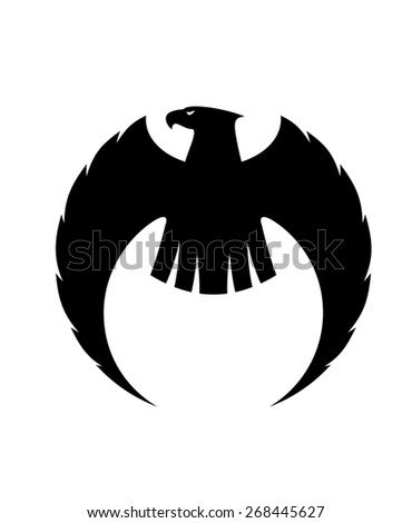 Powerful eagle silhouette with long curved wings and a fierce looking head turned to the side - stock photo