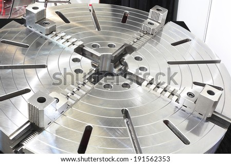 Powerful industrial equipment rotary table close-up - stock photo