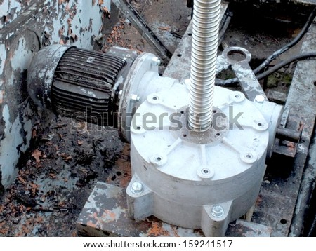 powerful industrial motor connected to the electric machine gear - stock photo