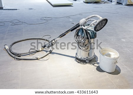 Powerful Industrial vacuum cleaner with a rotary brush head - stock photo