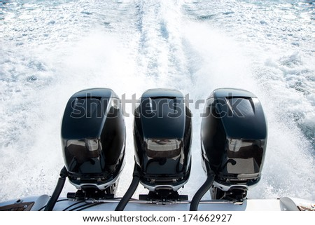 Powerful motor for sports boat - stock photo